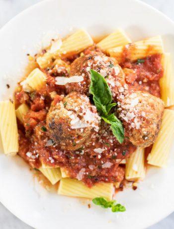 Dish of rigatoni and meatballs.