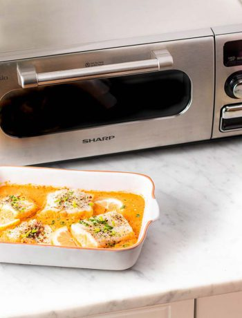 Sharp Coutertop Oven next to a dish of cod.