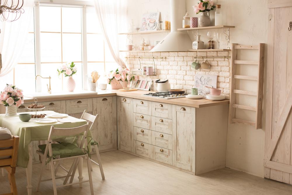 White rustic kitchen design near a window.