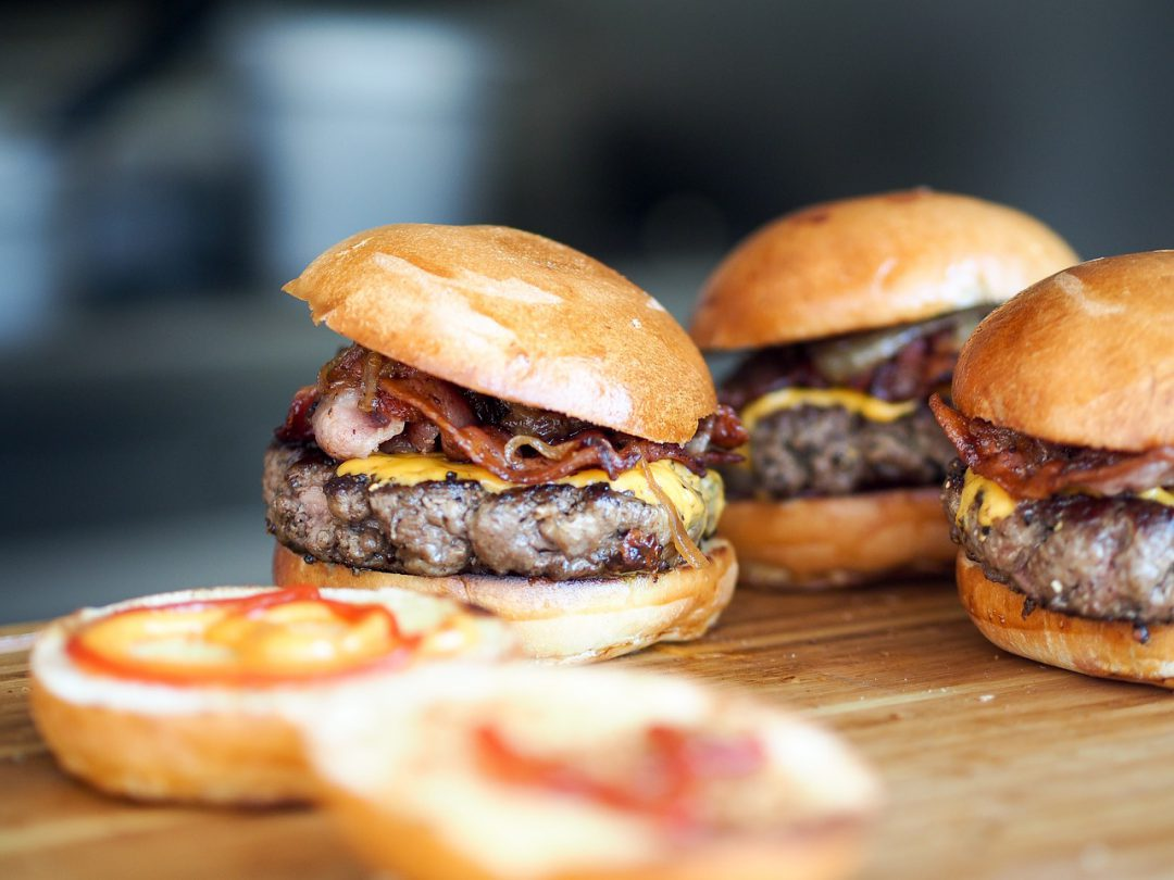Burgers on a wooden surface.
