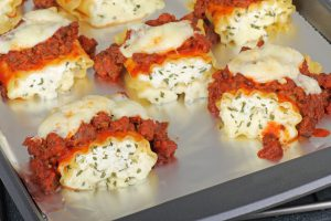 Lasagna roll ups on a tray.