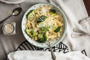 Chicken and broccoli on a tablecloth in a bowl.