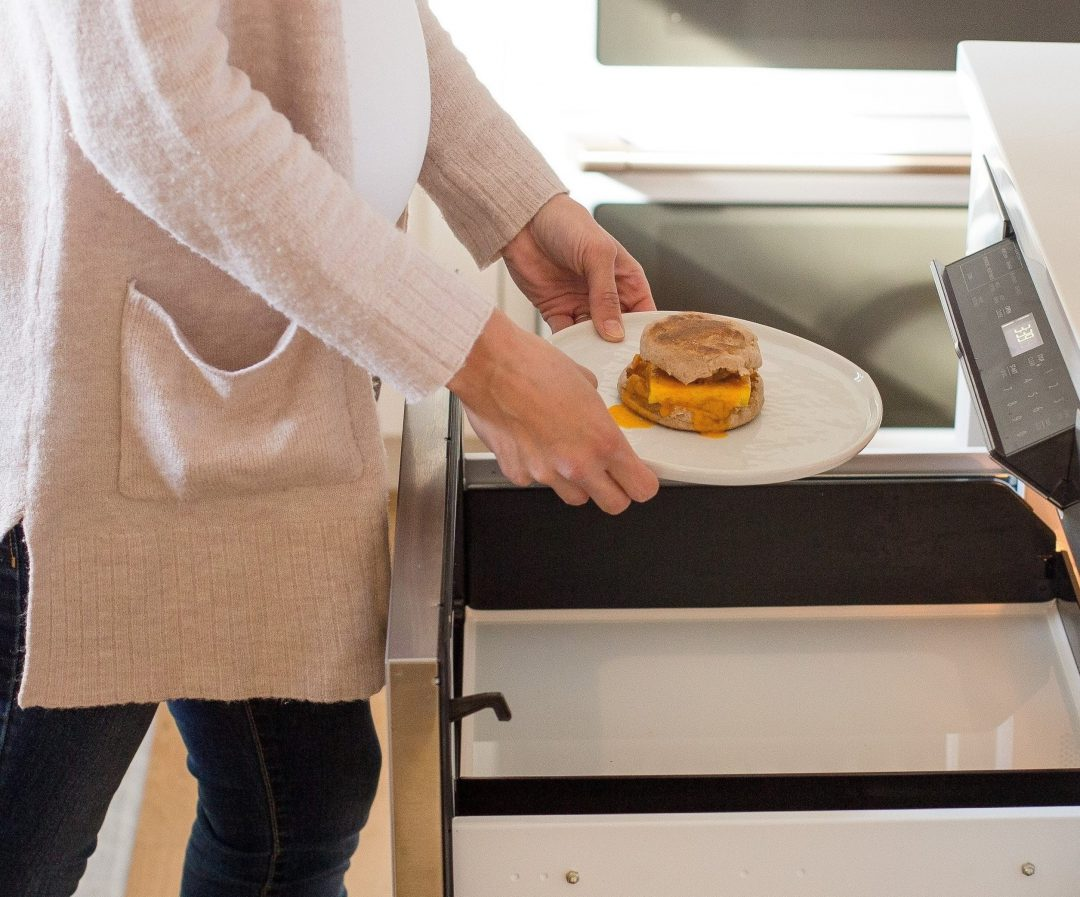 Breakfast sandwich in microwave drawer.