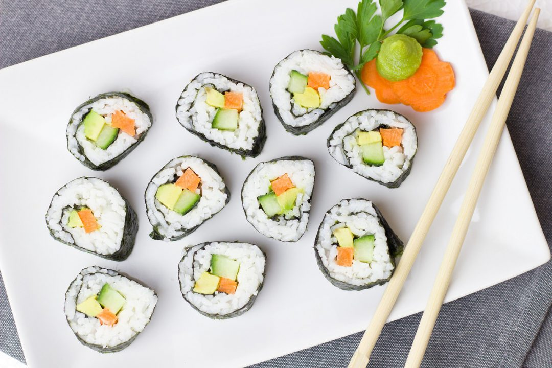 Sushi rolls on a board