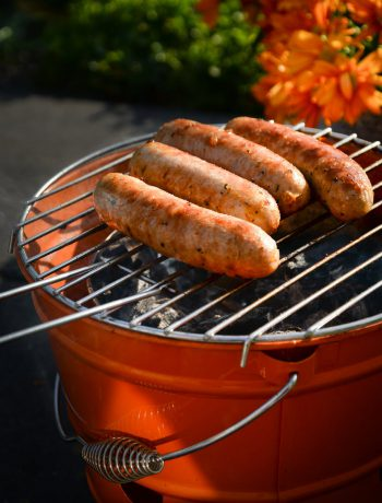 Hot dogs on a charcoal grill