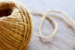 Roll of jute on a wooden surface.