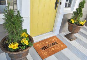 Doormat at an entryway in front of door.