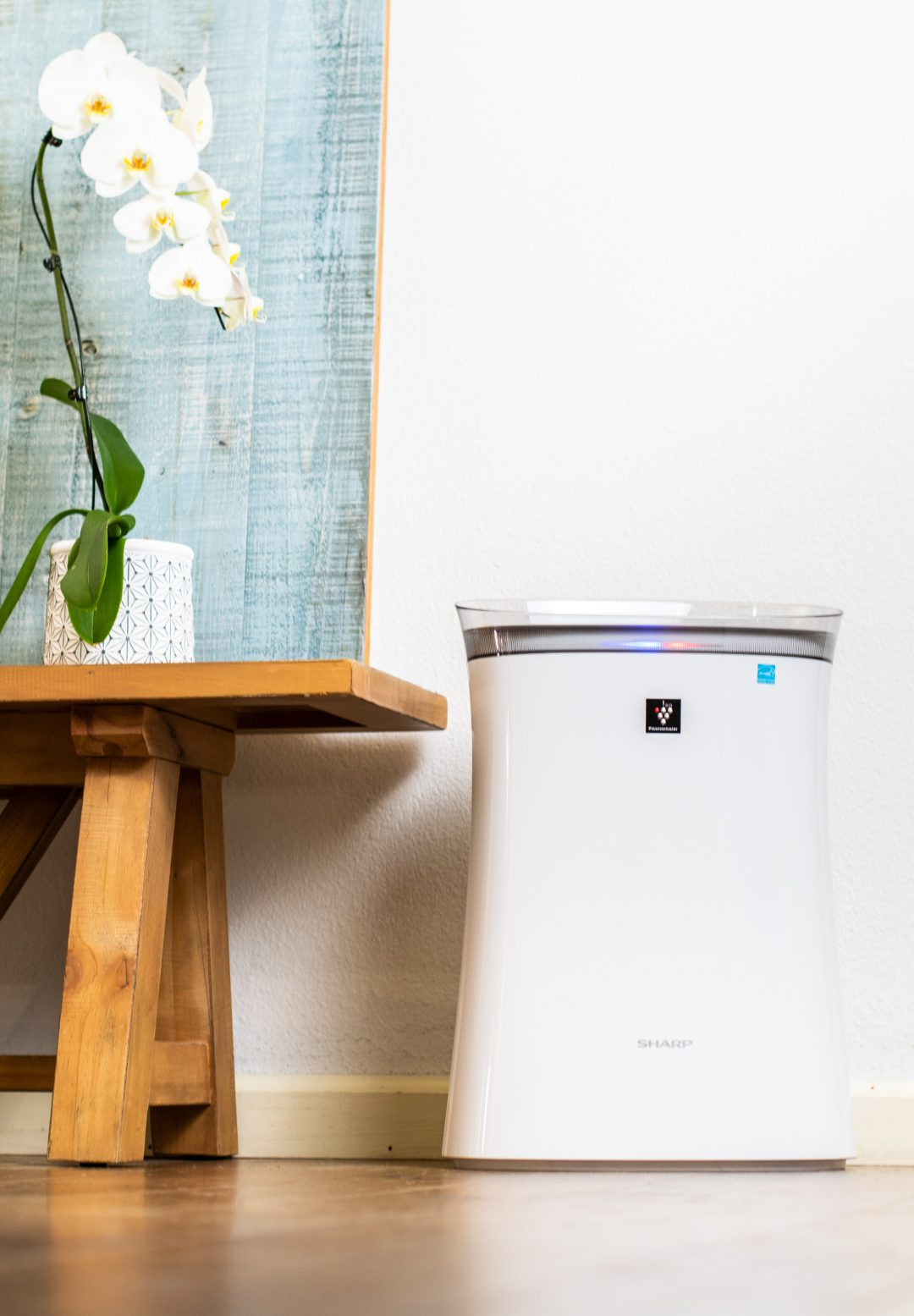 Sharp air purifier next to table