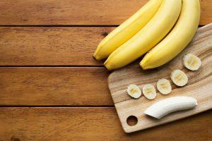 Chopped bananas on a cutting board.