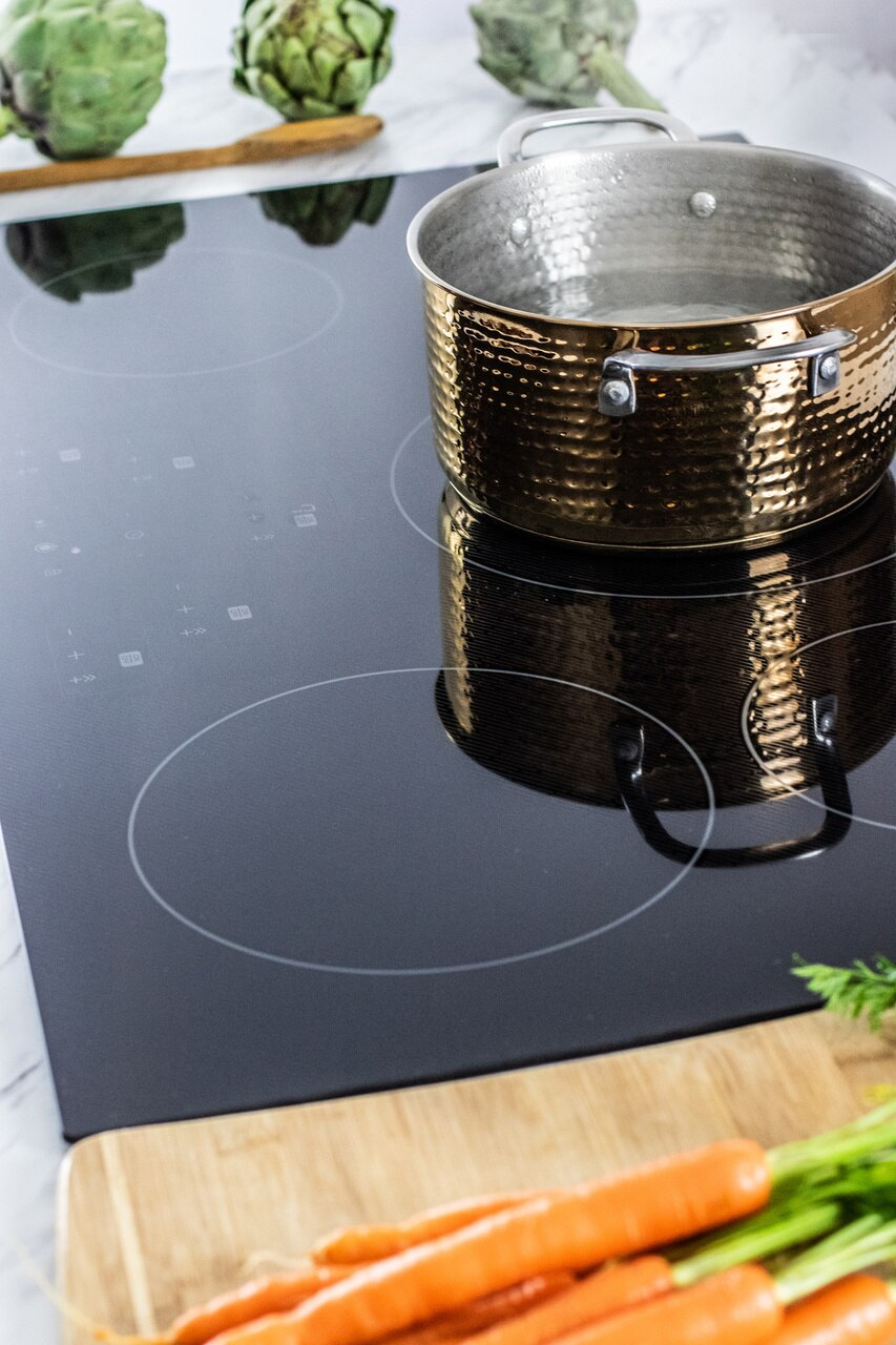 "36-Inch Black  Cooktop (SDH3652DB) – pot of water on the Sharp 36""  cooktop"