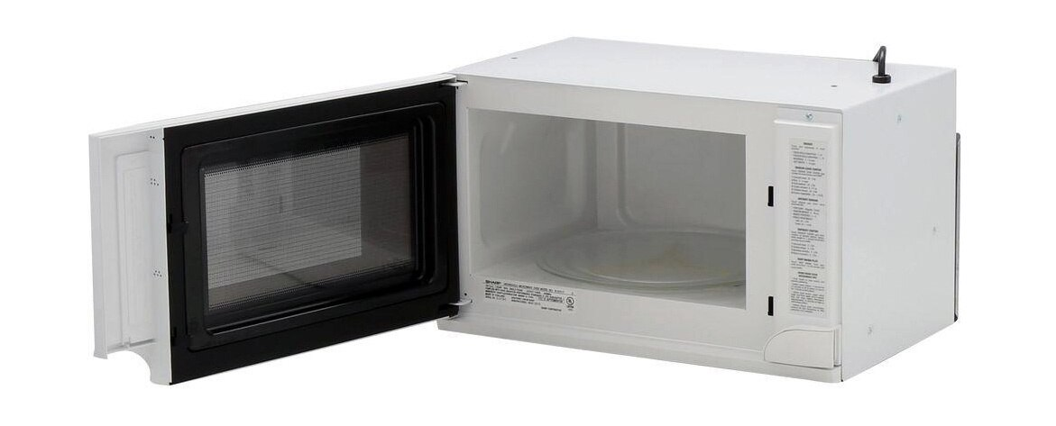 Sharp 1.5 cu. ft. Over-the-Counter Microwave in White (R1211TY) – left angle view with door open