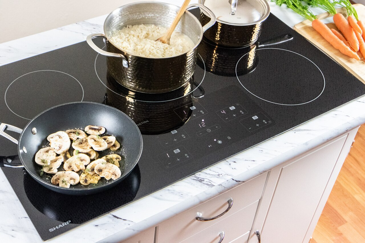 "36-Inch Black  Cooktop (SDH3652DB) - preparing a meal on the Sharp 36"" cooktop"