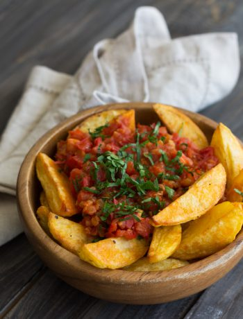 bowl of patatas bravas on a table