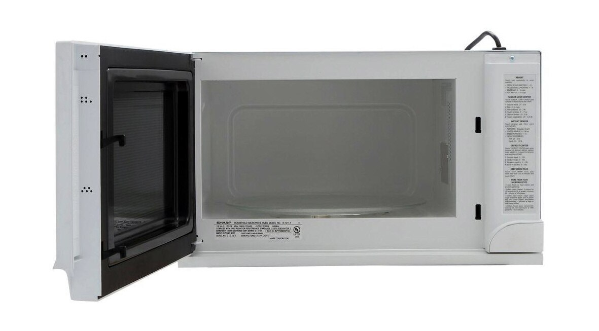 Sharp 1.5 cu. ft. Over-the-Counter Microwave in White (R1211TY) – front view with door open