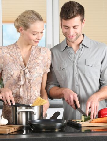 couple chopping vegetables in the kitchen