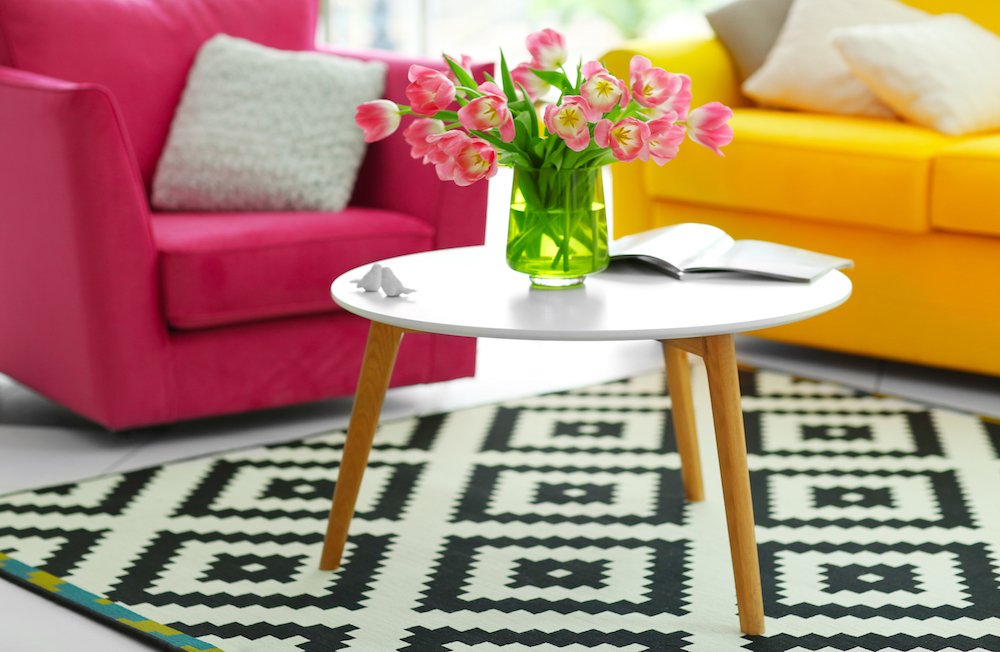coffee table surrounded by two sofas