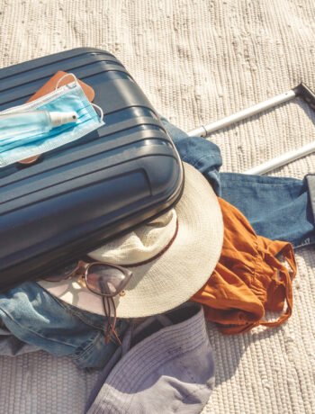 suitcase with clothing on a beach