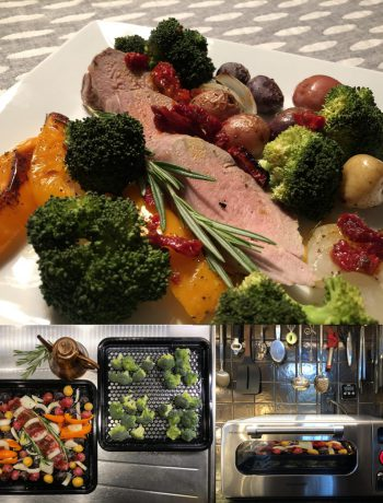 Pork tenderloin and broccoli cooking in a Sharp Countertop Supersteam Oven.