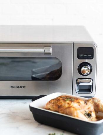 chicken dish next to Sharp Superheated Steam Countertop Oven