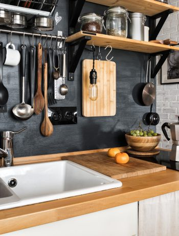 Urban and modern kitchen design with ingridients and utensils.