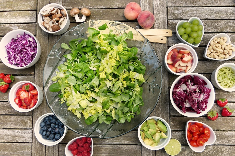 Basic salad with bowls of ingedients.