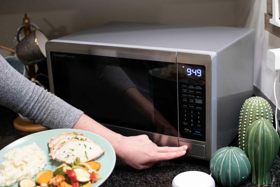 putting a plate of food in the microwave