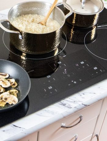 pots and pans cooking food on an induction cooktop