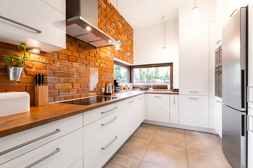 Modern designed kitchen with brick