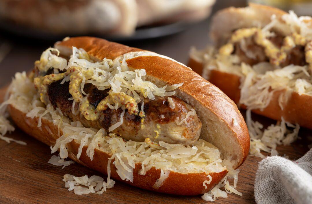 German sausage on a roll with sauerkraut