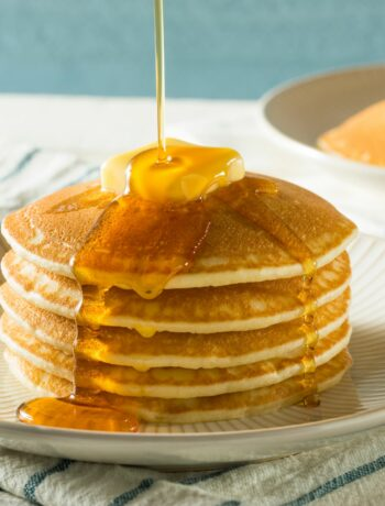 stack of pancakes with butter and syrup drizzle