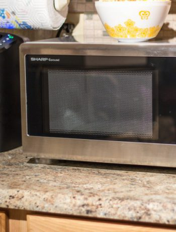 Sharp countertop oven next to coffee machine.