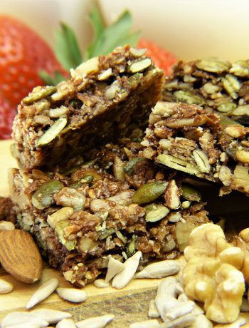 Granola snacks next to strawberries.