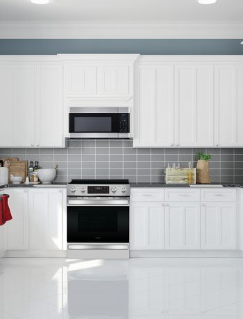 White kitchen design with grey backsplash.