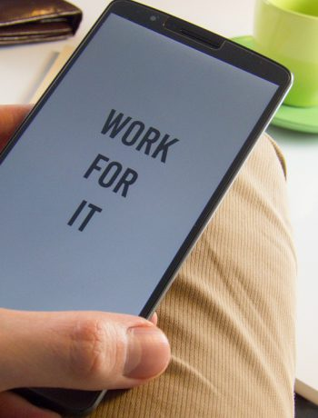 "Motivation quote ""Work For It"" on a smartphone."