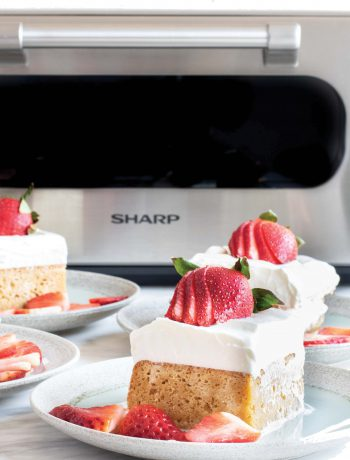 Four cakes on plates next to Sharp Supersteam Countertop Oven.