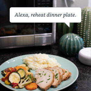 Alexa Voice Command in text in front of plate and Sharp Smart Microwave