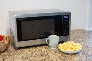Microwave coffee and popcorn.