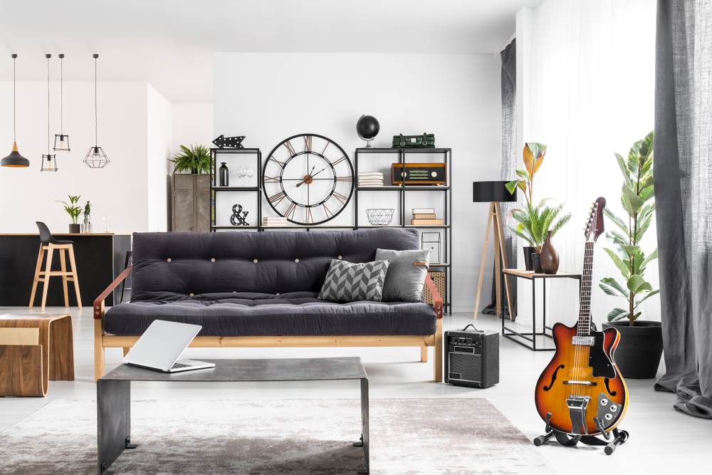 Modern man cave setting with couch and guitar