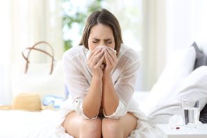Young female sneezing