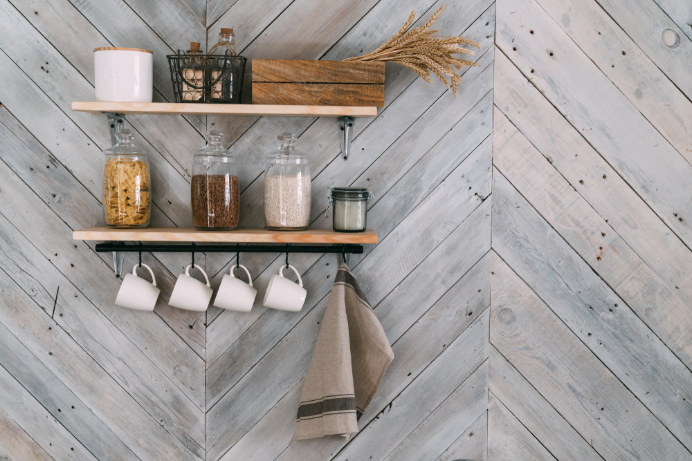 Floating shelves with kithen ingridients on a wooden wall.