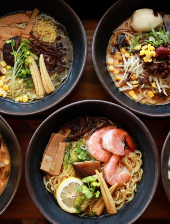 Ramen bowls across a table
