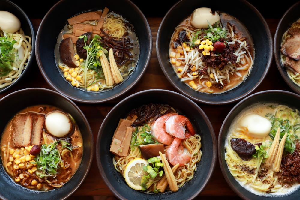 Ramen bowls across a table