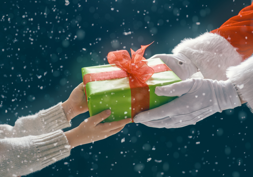 Santa Claus giving a child a present