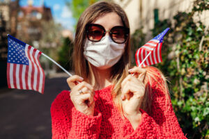 Woman celebrating Labor Day in mask