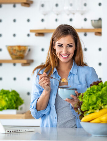 Young female in kitchen practicing sustainability