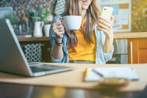 Woman working from home with a coffee cup