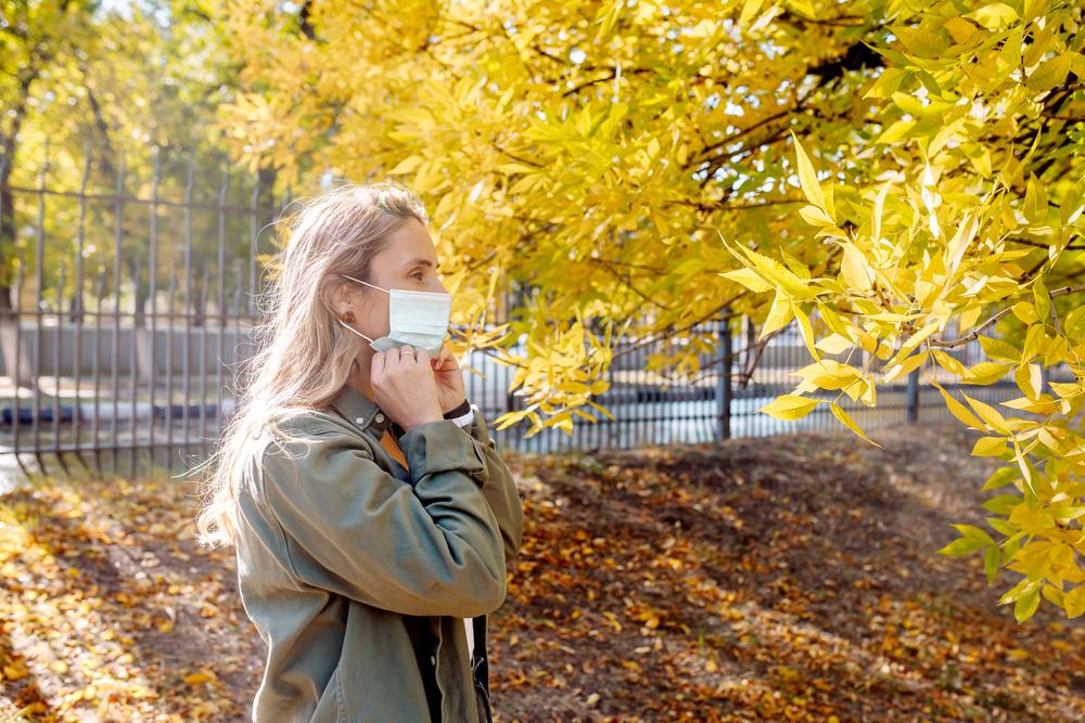 Woman enjoying nature with mask