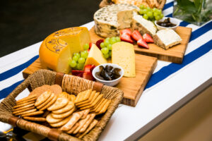 Food displays across the a board at a picnic.