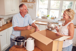 Older couple packing items an