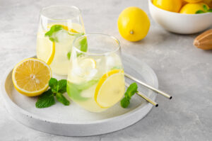 Lemonade with lemons on a table.